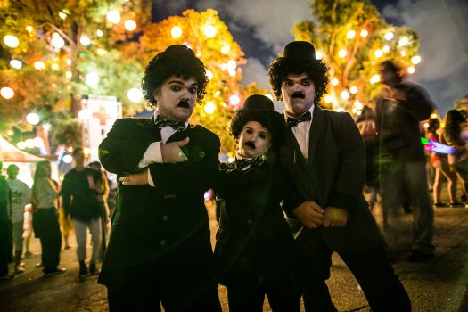 Three performers dressed like Charlie Chaplin
