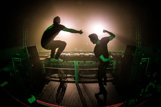 Two DJs silhouetted