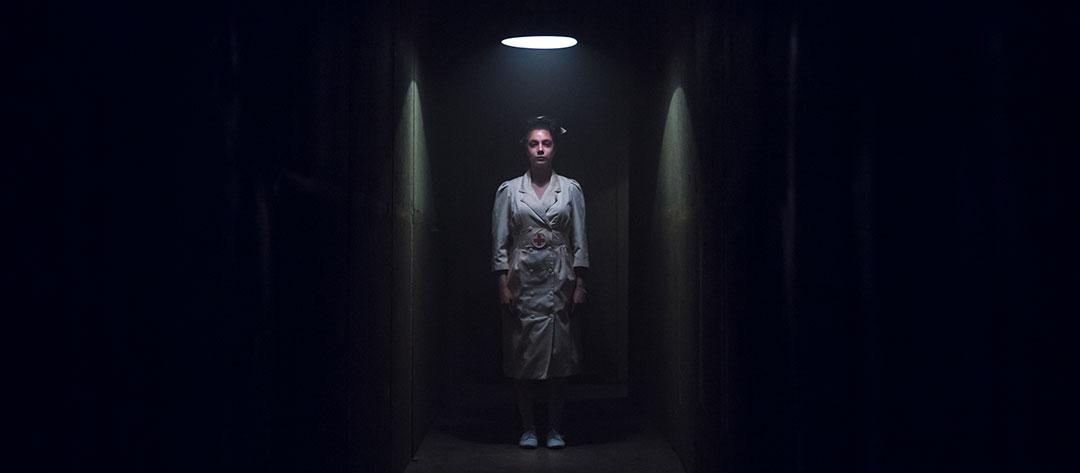 A nurse lurks in a hallway