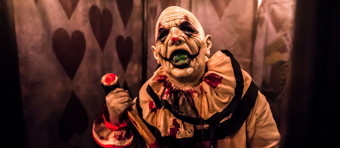 A scary clown with a mallet