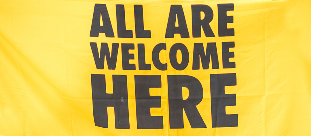All are welcome here sign