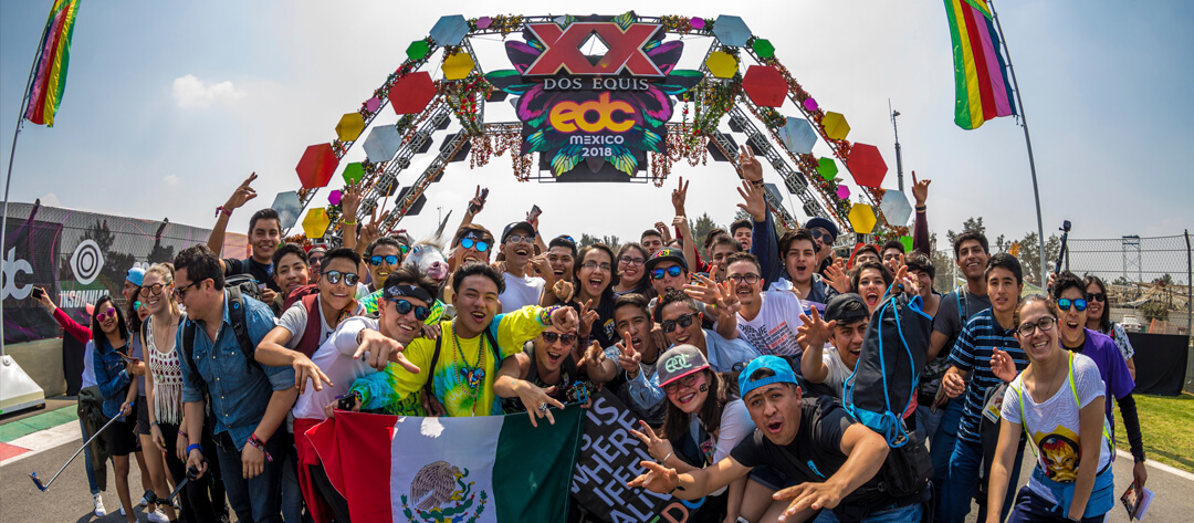 Headliners posing for a picture under the EDC Sign
