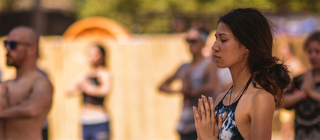 Yogis with hands in prayer