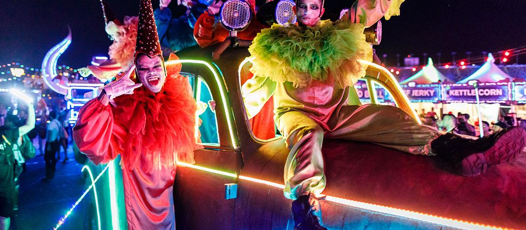 Clown performers on an art car