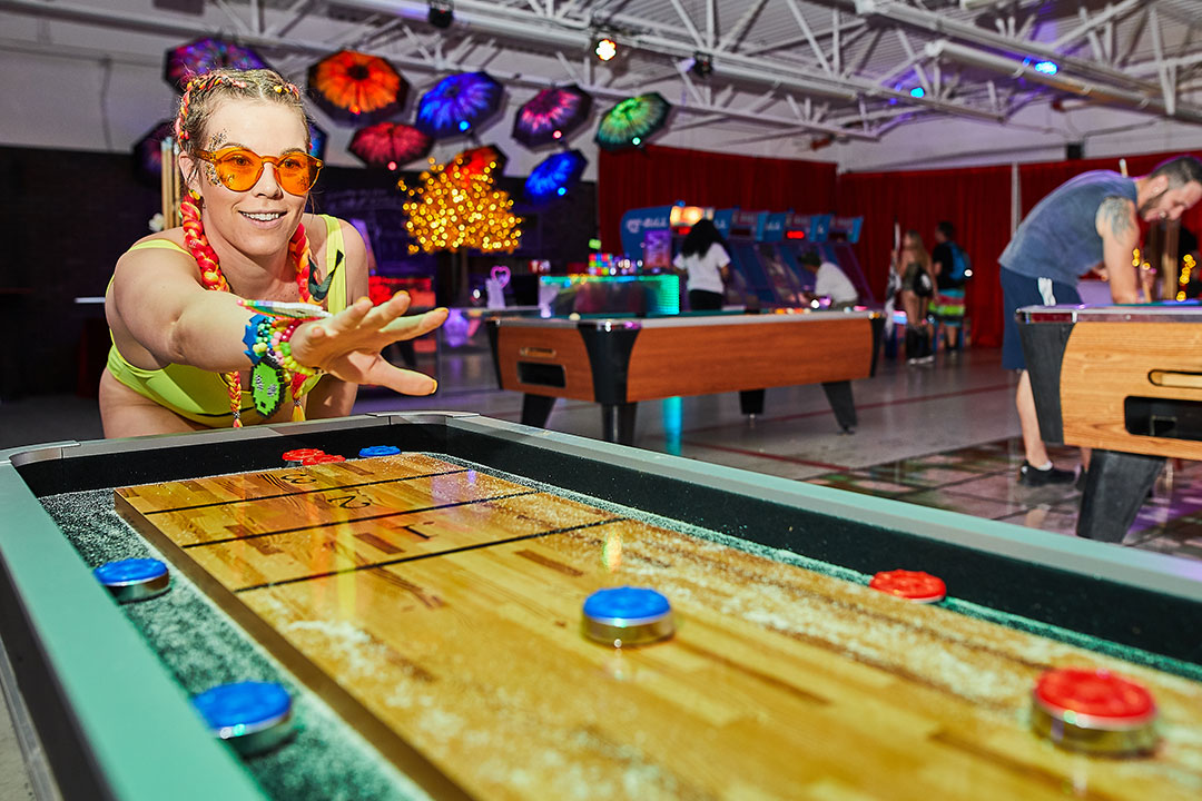 A woman playing shuffleboard