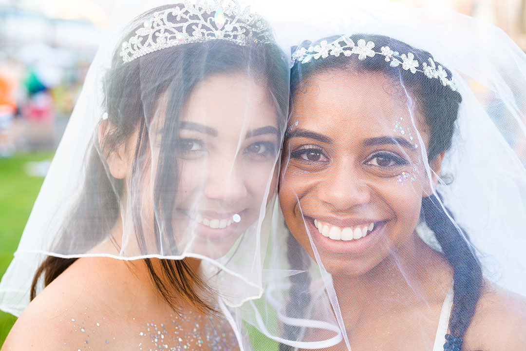 Two girls in veils