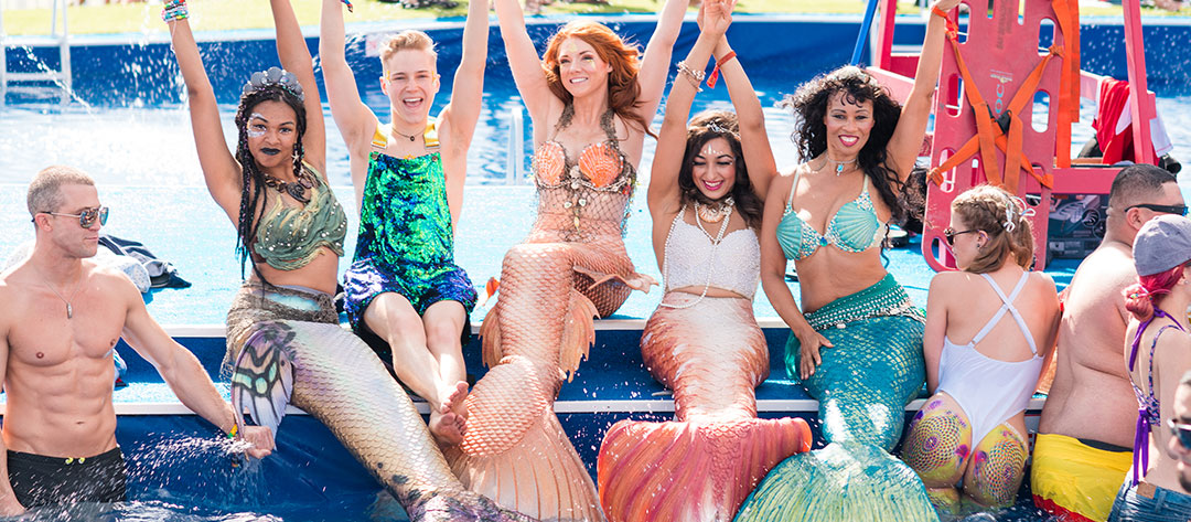 Women in mermaid costumes