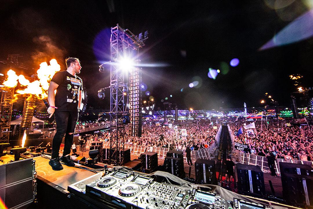 A DJ stands on the decks
