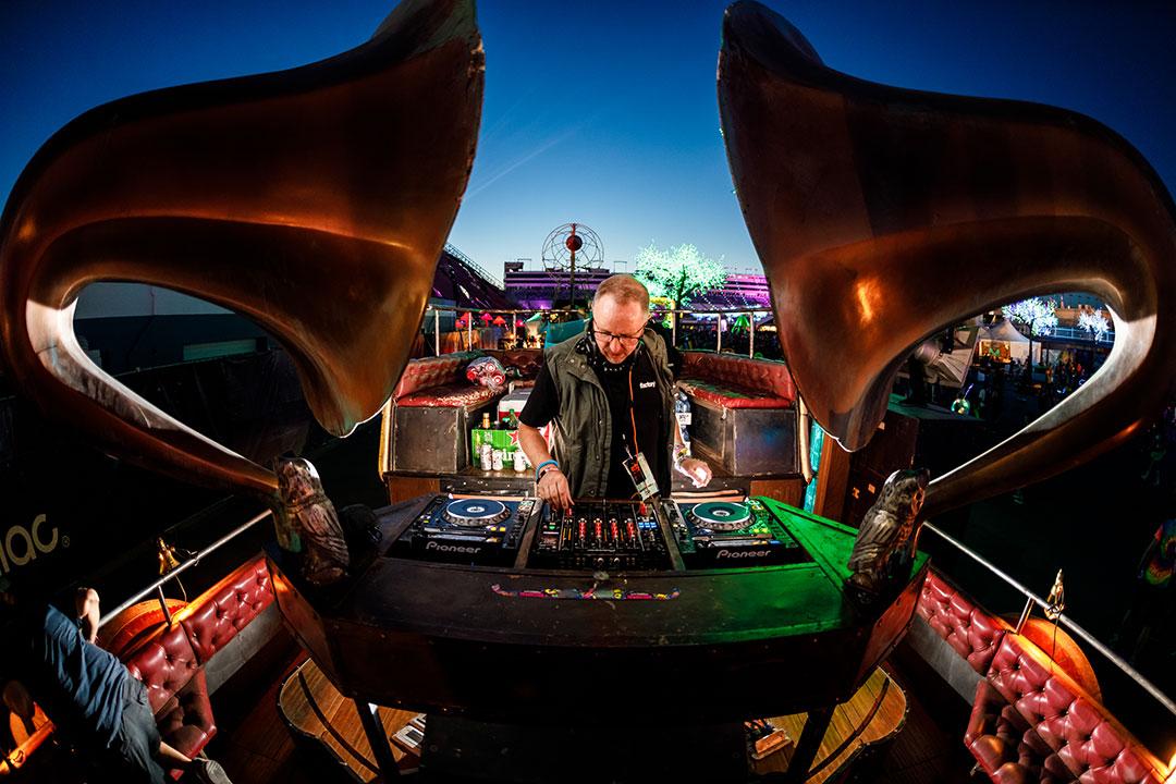 A DJ plays on an art car