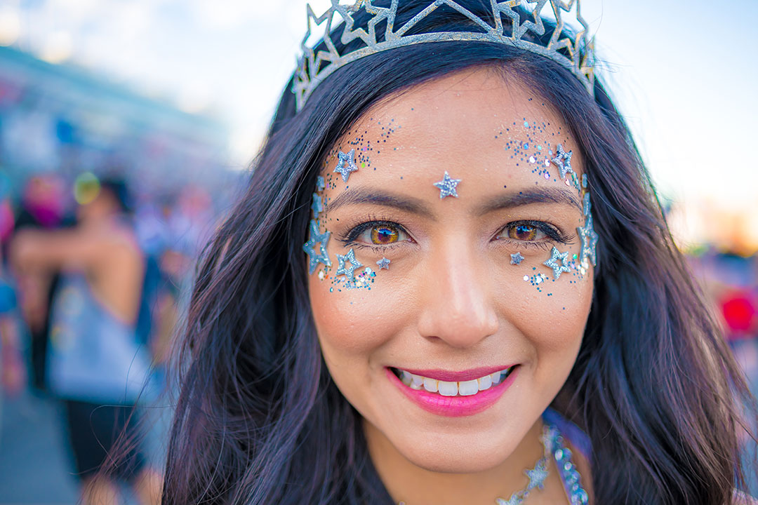 A closeup of a girl with face jewels