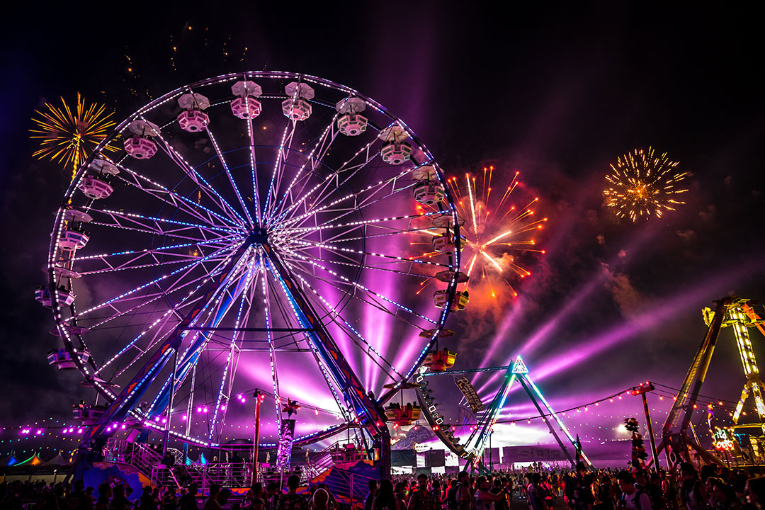 A Ferris wheel and fireworks