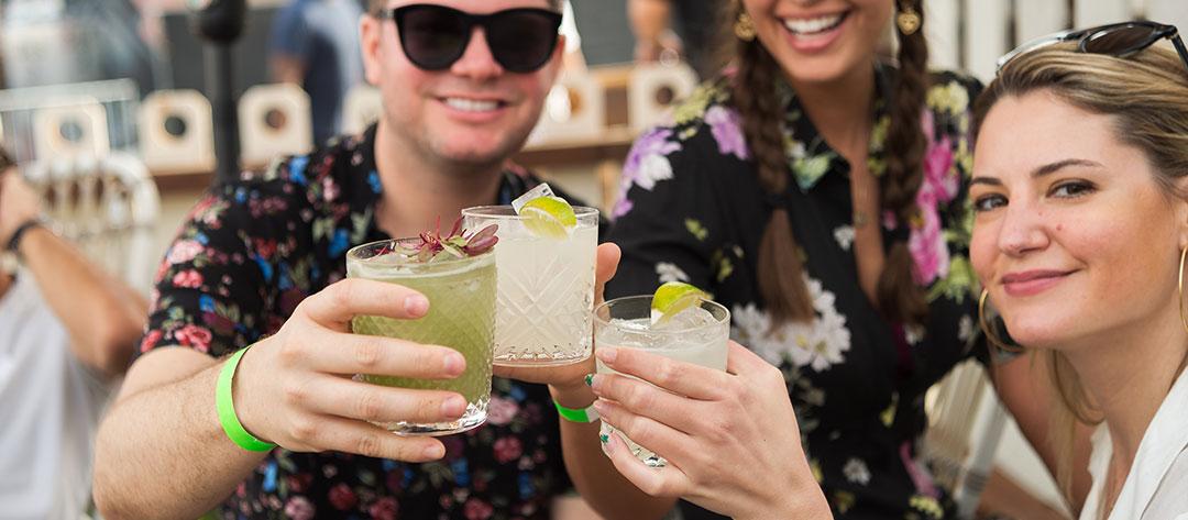 Headliners toasting cocktails