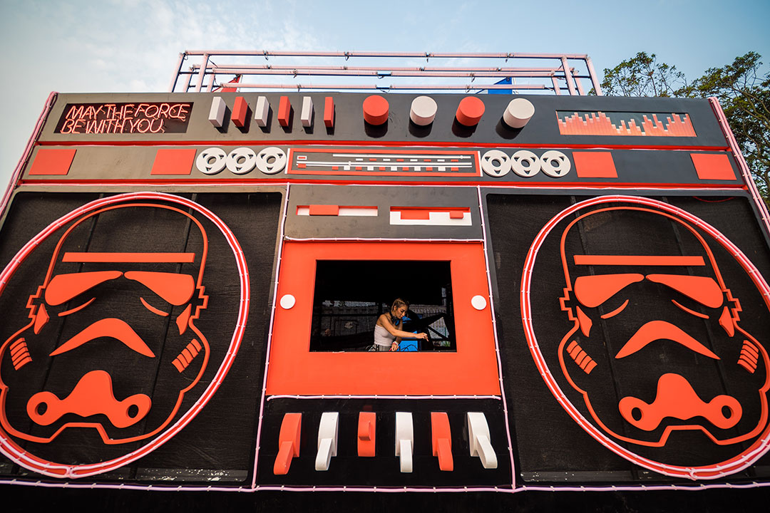 A DJ inside the tape deck of a giant boombox
