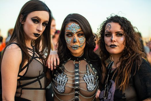 girls dressed up in skull makeup