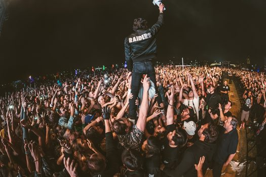 Man standing on the crowds shoulders