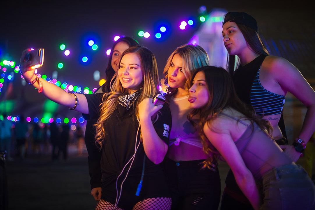 Women pose for a group selfie