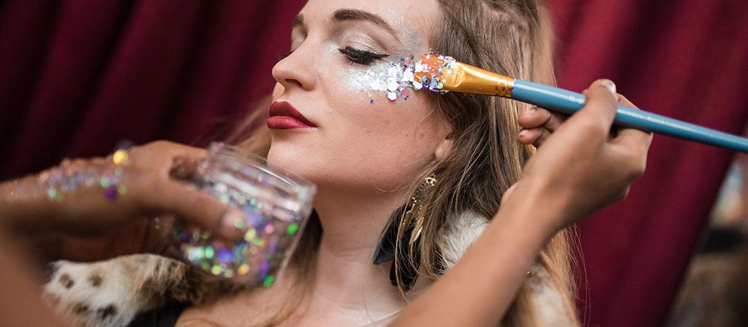 A woman receiving glitter makeup