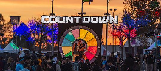 Headliners pose in front of the Countdown sign