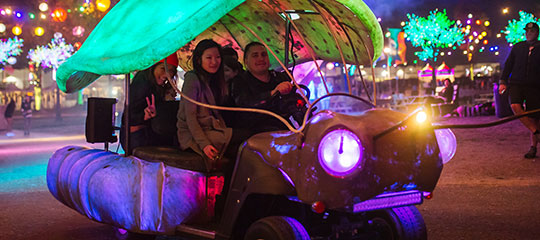 People driving an art car