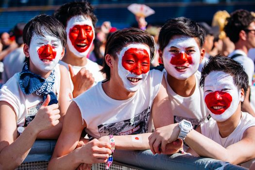 Headliners paint their faces like the Japanese flag