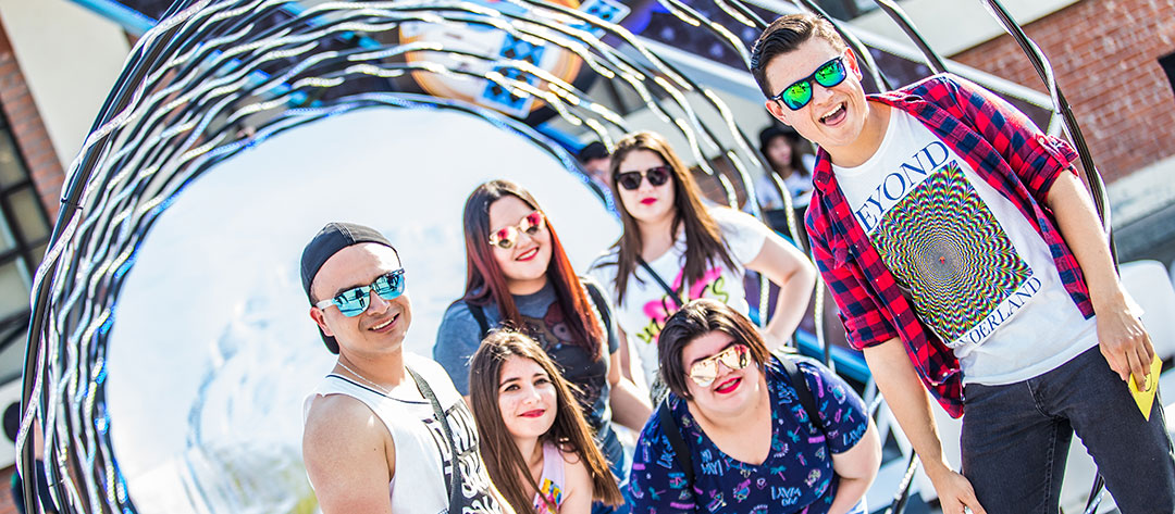 Headliners pose in front of a tunnel
