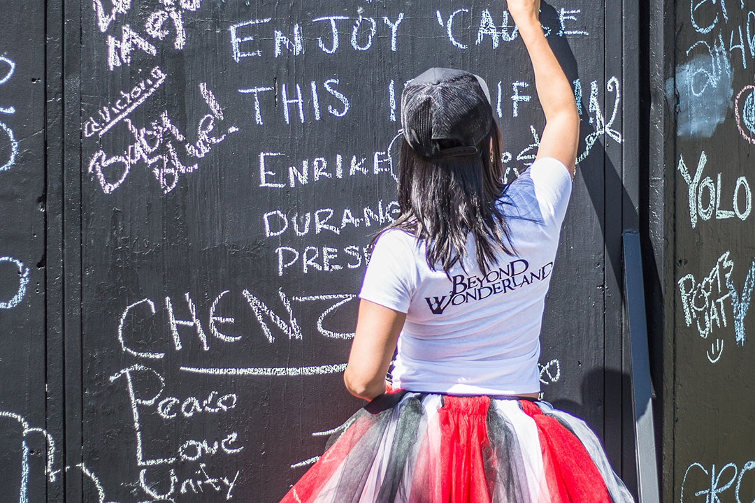 A woman writes on the unity wall