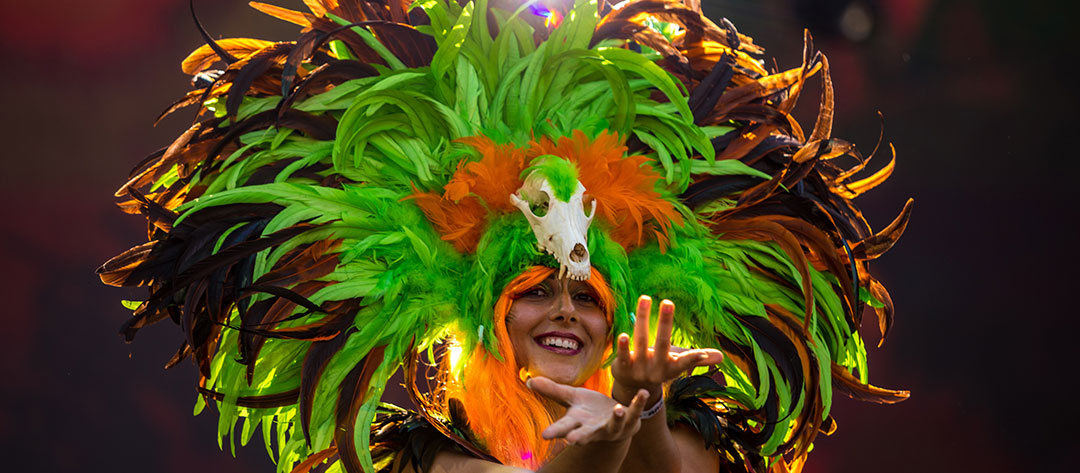 A performer in a feather headdress