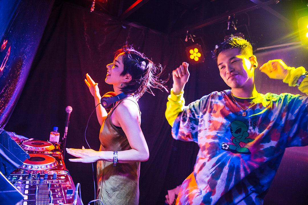 DJs inside the Boombox art car