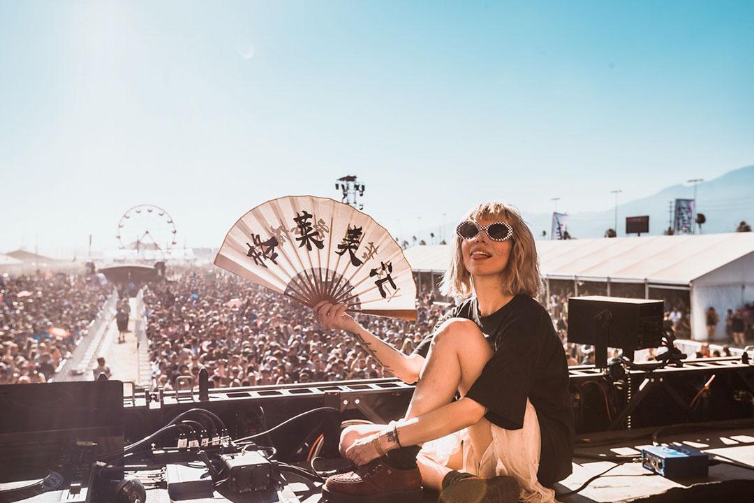 A DJ with a fan
