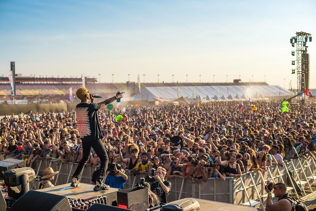 A DJ greets the crowd