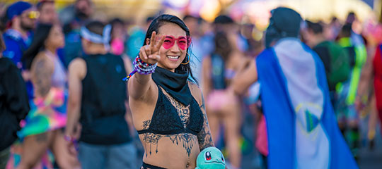 A woman making a peace sign