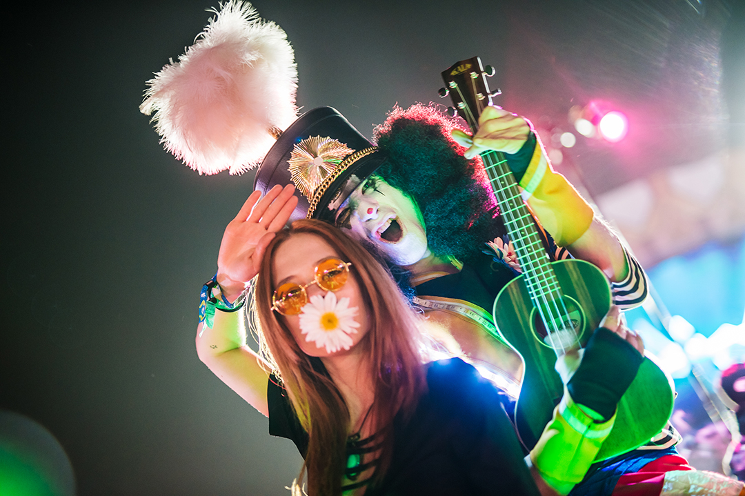 A Headliner with a costumed performer