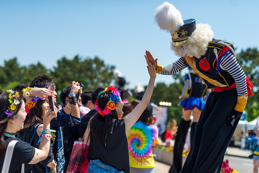 Our costumed performers are always ready with a smile and a hi-five.