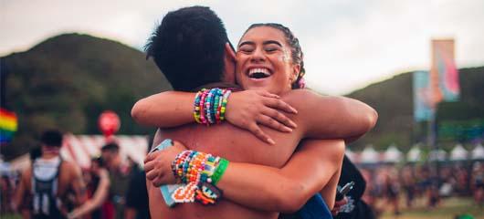 headliners hugging happily