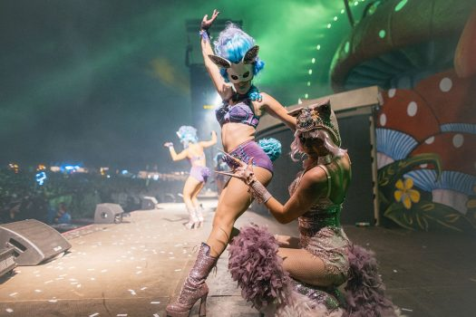 Costumed performers dance onstage at Beyond Wonderland SoCal 2015