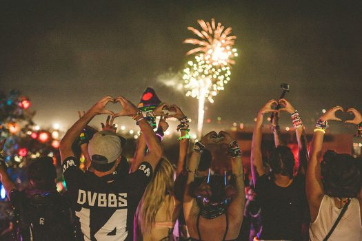 Headliners make heart-hands during fireworks at Beyond Wonderland SoCal
