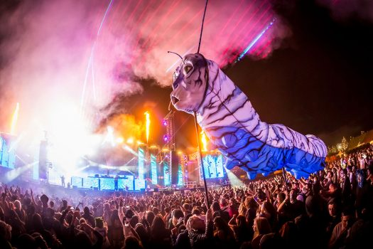 Giant caterpillar puppet moves over the crowd at Beyond Wonderland SoCal