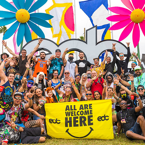 Headliners with 'All Are Welcome Here' banner