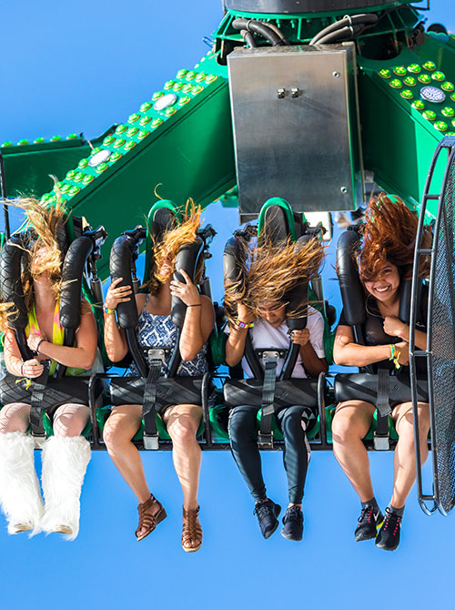 Headliners enjoy a carnival ride at EDC Orlando