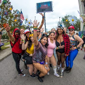 "A group of excited Headliners with a ""Raver Things"" totem"