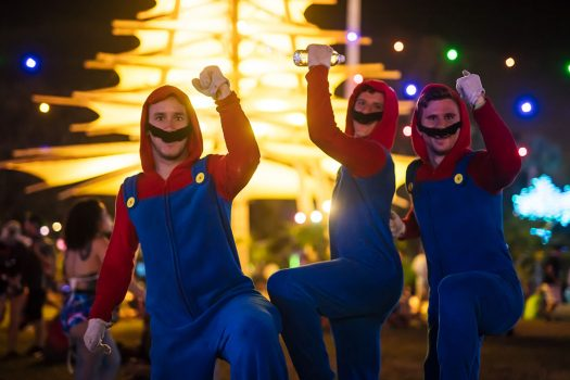 Three Headliners dressed like Super Mario Bros.