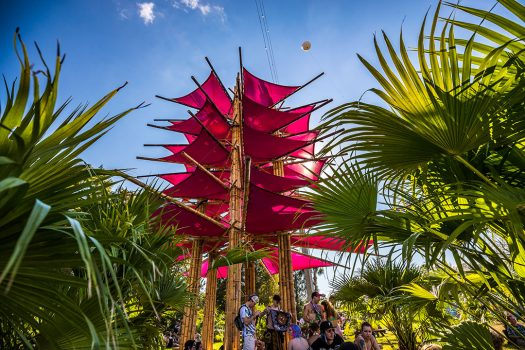 A pink art installation among tropical greenery