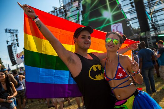 Two Headliners with a rainbow flag