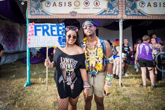 "Headliners with a ""Free Hugs"" totem in front of the Ground Control Oasis"