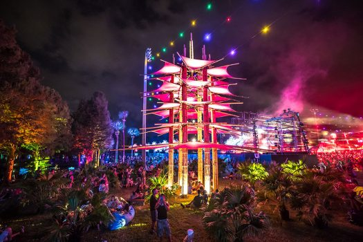 Headliners chill by a glowing art installation