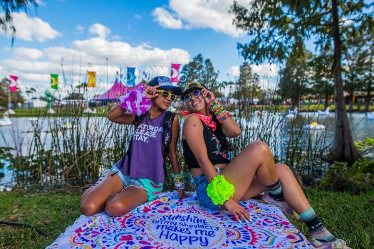 Two Headliners on a blanket by the pond