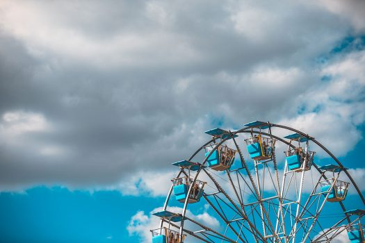 A Ferris wheel and clouds