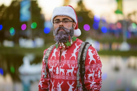 A bearded Headliner dressed in a Christmas theme