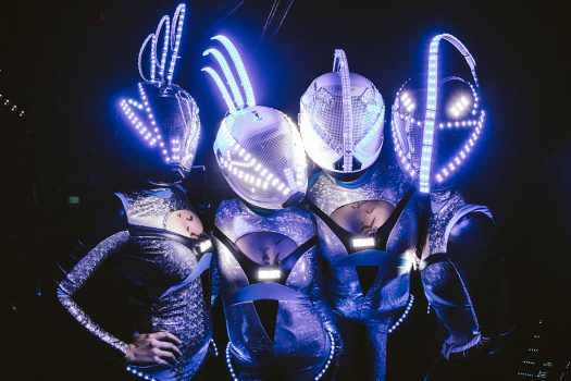 Four space-inspired performers with light-up helmets