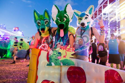 Three Headliners with wolf masks and a pizza raft